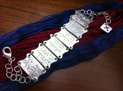 The Lord's Prayer in Galilean Aramaic cast in pewter.