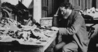Solomon Schechter studying documents from the Cairo Geniza, c. 1895.